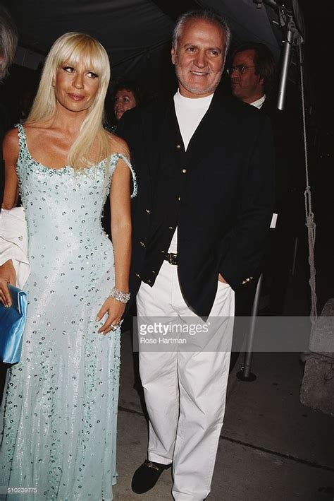 Italian fashion designer, Gianni Versace with his daughter