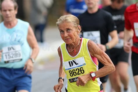Old Lady In Good Shape Running Editorial Stock Photo