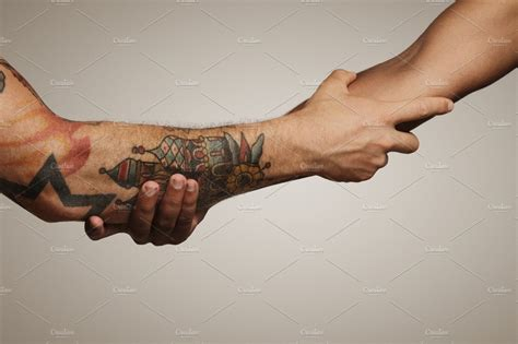 Close up shot of a forearm handshake ~ People Photos